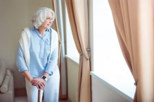 lonely-senior-woman-with-crutch